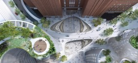 An aerial view of the square featuring layered vegetation and an interactive fountain.web